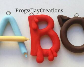 Custom polymer clay initials