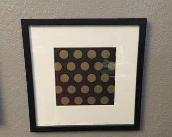Four framed gold black and white corrdinating wall art.