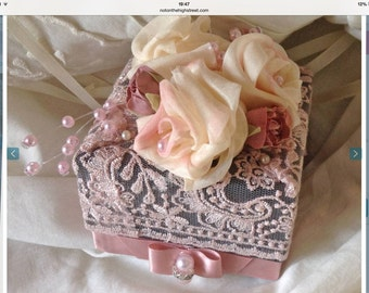 A gift decorated with hand made silk roses