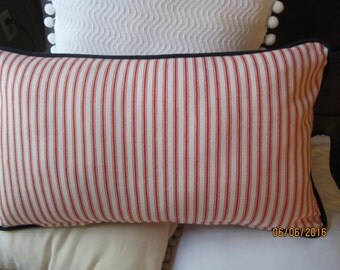 Red and white striped cotton twill throw pillow with blue cording