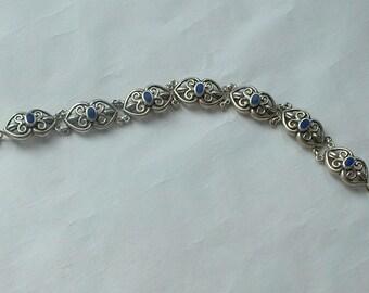 Silver and enamel panel link bracelet