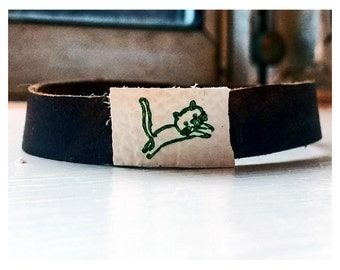 Leather wrist cuff with jumping cat print 1