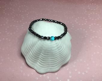 Faceted hemitite and quartz stretch bracelet