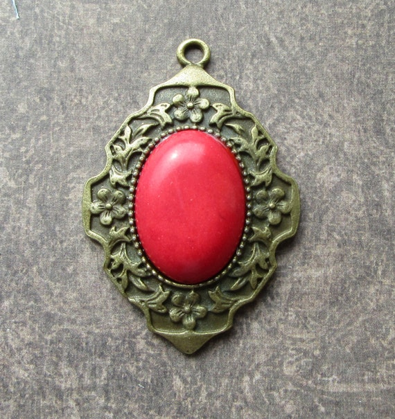 Red Bronze Stone : Red synthetic turquoise stone cabochon oval pendant