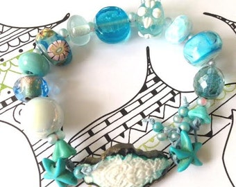 Turquoise Maldives bracelet, ceramic and lampwork shades of the ocean