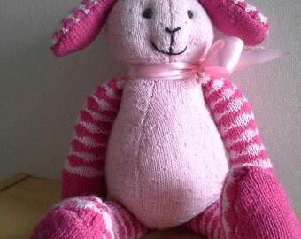 Pink rabbit with floppy ears.