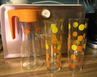 Vintage Atomic Design Pyrex pitcher and 4 glass set