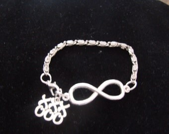 Silver Tone Infinity Charm And Hugs And Kisses Charm Bracelet