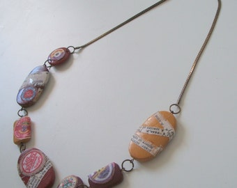Upcycled necklace -  flat bead necklace in red, purple & yellow. Fabric wrapped necklace. Colourful preloved necklace with decoupage beads