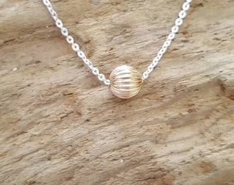 Sterling silver necklace with a 9ct Gold 6mm corrugated bead