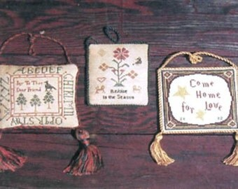 A Trio of Ornaments by Handwork Samplers
