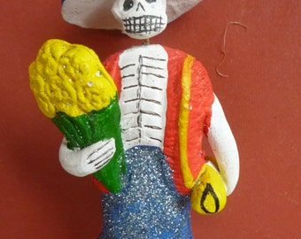 Skeleton, Catrina, holding yellow flowers, made in Mexico