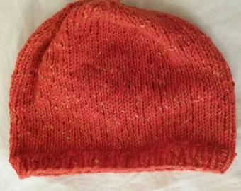 Handknitted hat in orange wool and angora