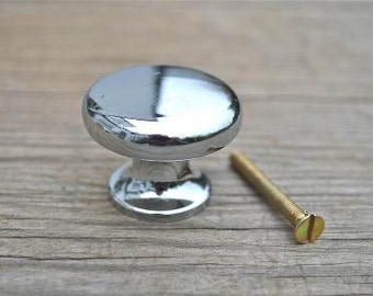 A chrome solid brass plain door knob GW10