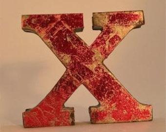 A fantastic vintage style metal 3D red letter X