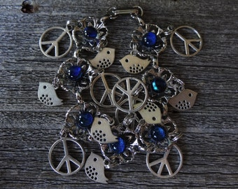 Darling bird and peace sign dichroic fused glass charm bracelet