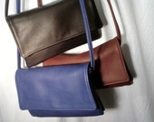 Sm. Leather crossbody and shoulder bag w/multi compartments and adjustable strap.Style #903