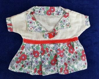 Child's sized vintage clothespin holder hanging dress