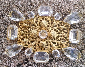 Goldtone Filigree surrounded by Glass Multifaceted Stones..Vintage 1970s