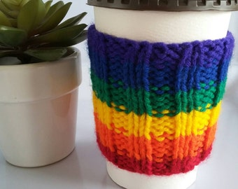 Sleeve of coffee without knitting grip Cup. Comfortable. Wool. Representing the colors of the Rainbow pride guai