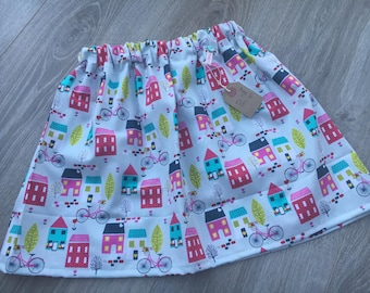 Girls Handmade Skirt grey. pink, turquoise houses and bicycles print fabric Age 6