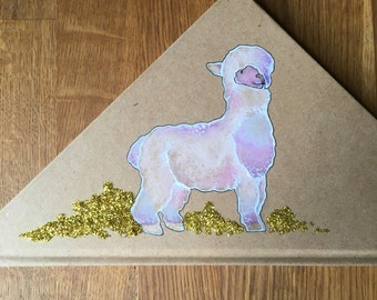 Hand -illustrated alpaca notebook . Triangle shaped.