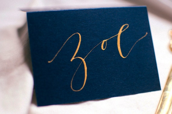 Navy blue modern calligraphy place card with gold ink