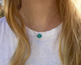 Gold chain with turquoise cross