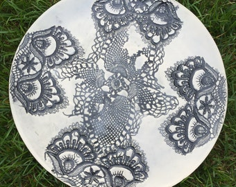 Round lace in porcelain plate dish