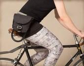 Pochette de taille en coton ciré noir pour cadenas de vélo. Sac banane.