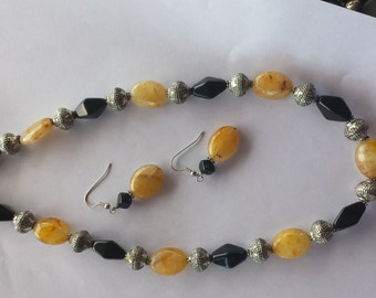 NECKLACE-EARRING SET(Order 3 jewelry items for 9.00 shpg)Silver ball pieces/black gems,gold unique beads,earrings(Was 69 now 35)
