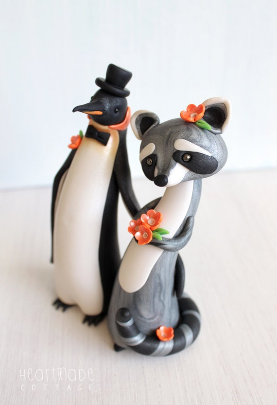 penguin wedding cake topper uk wedding cake topper raccoon and penguin groom 18189