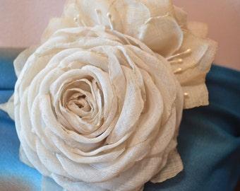 Brooch rose.The linen fabric.