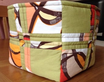 Basket/box/storage container/nappy caddy with patchwork, quilting and waterproof lining.  Reversible.