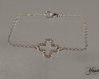 Sparkling clover leaf on silver