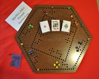 Marbles Pursuit/Joker 6 player game board with 4 player inlay comes with 3 decks of cards, marbles,instructions and 3 quick reference cards.