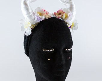 Beautifully Twisted White Demon Horns with Sweet Floral Detail