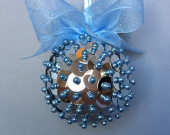 Silver Seequin Christmas Ornament With Light Blue Accents