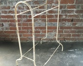 Turn of the Century metal blanket rack. Use in bathroom for towels or poolside. Original white paint. Loads of character.