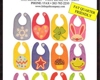 Sewing Pattern for 12 Holiday Themed Baby Bibs Unused and Uncut from the Little Quilt Company Applique Baby Toddle Size