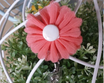 coral/peach and white flower badge reel; ID holder; nametag