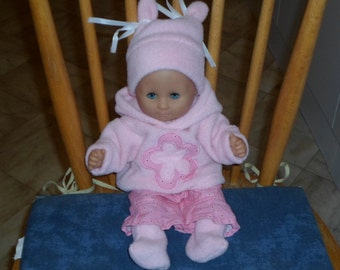 Cute baby doll baby born in pink fleece clothing Zapf creation Germany