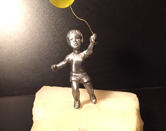 Boy with Balloon Sculpture, in the style of Jere