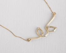 Dainty 14k necklace , unique 14k necklace , delicate 14k necklace , gold branch necklace , gold leaf necklace , 14k gold pendant , gold leaf