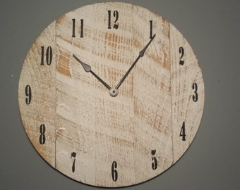 """Rustic Wall Clock 18"""". Made from rough cut lumber. Distressed and finished to give it that barnwood / reclaimed lumber look."""