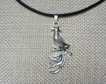 Fawkes Phoenix pendant on a choker. Comes with a free gift bag. Inspired by Harry Potter.