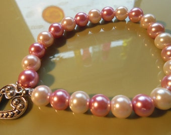 Two toned pink pearl bracelet with heart charm