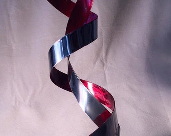 "stainless steel sculpture ""Cyclone passion"""