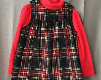 Plaid corduroy jumper with red turtleneck