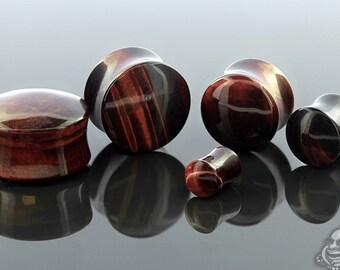 "Red Tiger's Eye stone plug 6g, 4g, 2g, 0g, 00g (9.5mm), 7/16"", 1/2"" (13mm), 9/16"", 5/8"", 3/4"", 7/8"", and 1"""